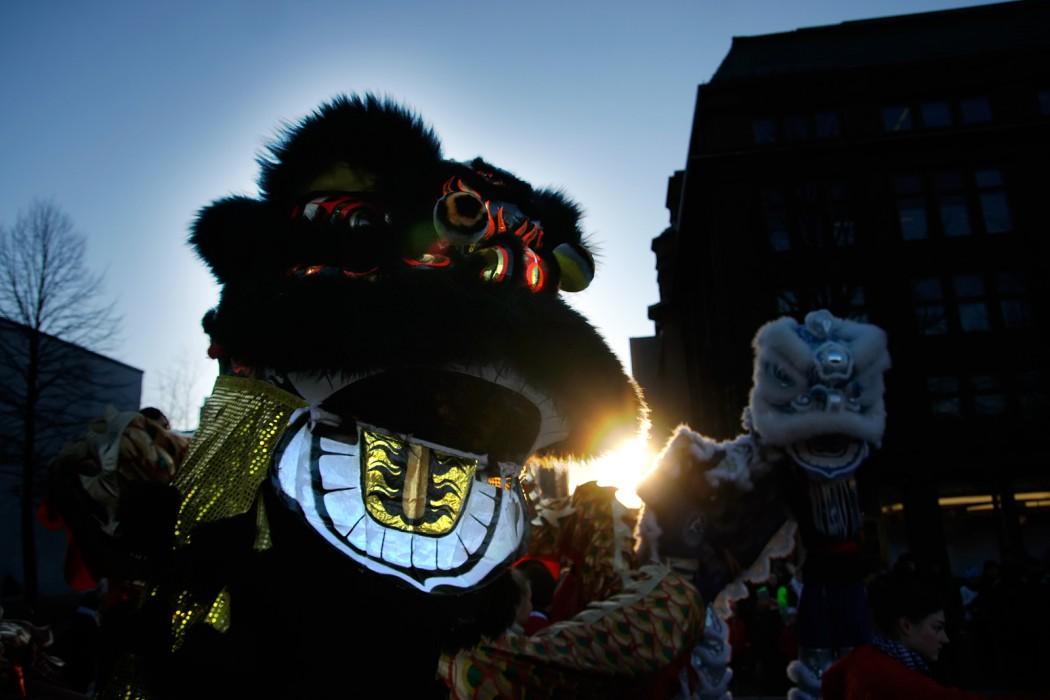 Lion dancers are getting ready for their performance behind the stage. Picture: Tony Öhberg for Finland Today
