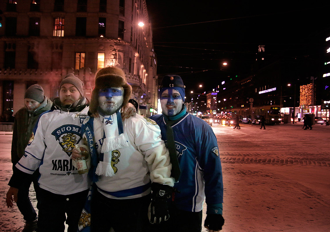 A group of revelers celebrating the world championship gold of the Young Lions while standing in the corner of Mannerheimintie in Helsinki on Wednesday, January 6, 2016. Picture: Tony Öhberg for Finland Today