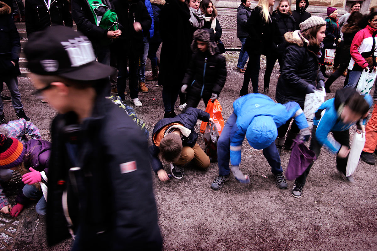 About 4,100 seniors (abit) from upper secondary schools around Helsinki attend 'penkkarit' in over 100 trucks cruising around the center. The children are picking up the candy thrown by the abit on February 18, 2016. Picture: Tony Öhberg for Finland Today