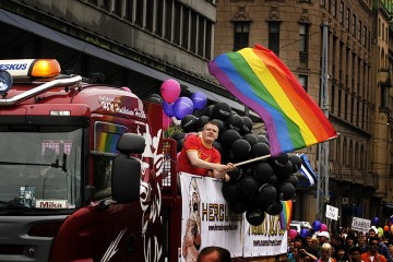 A man waving the rainbow flag during Pride Parade in Helsinki,  June 2013. Picture: Tony Öhberg for Finland Today