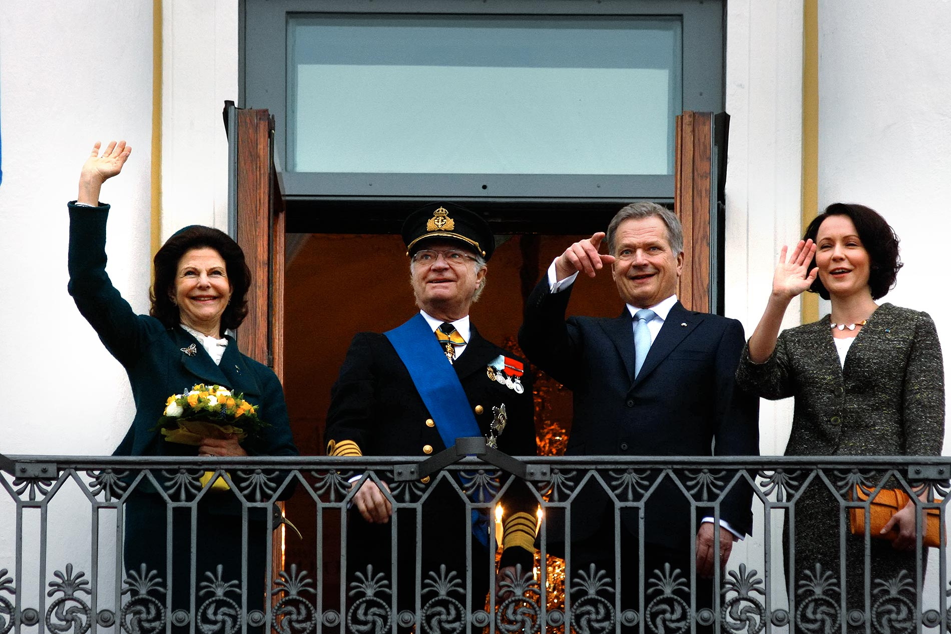 H.M. Queen Silvia and King Carl XVI Gustaf of Sweden and the Finnish presidential couple, President Sauli Niinistö and Mrs Jenni Haukio, waving from the balcony of the Presidential Palace to the crowd of a few hundred standing on the Market Square in Helsinki, Finland on Tuesday, March 3 2015. Picture: Tony Öhberg for Finland Today