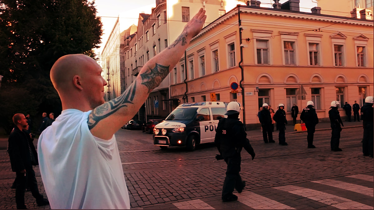 A man giving the Heil Hitler salute to the opponents of racism in October 2015. Picture: Tony Öhberg for Finland Today