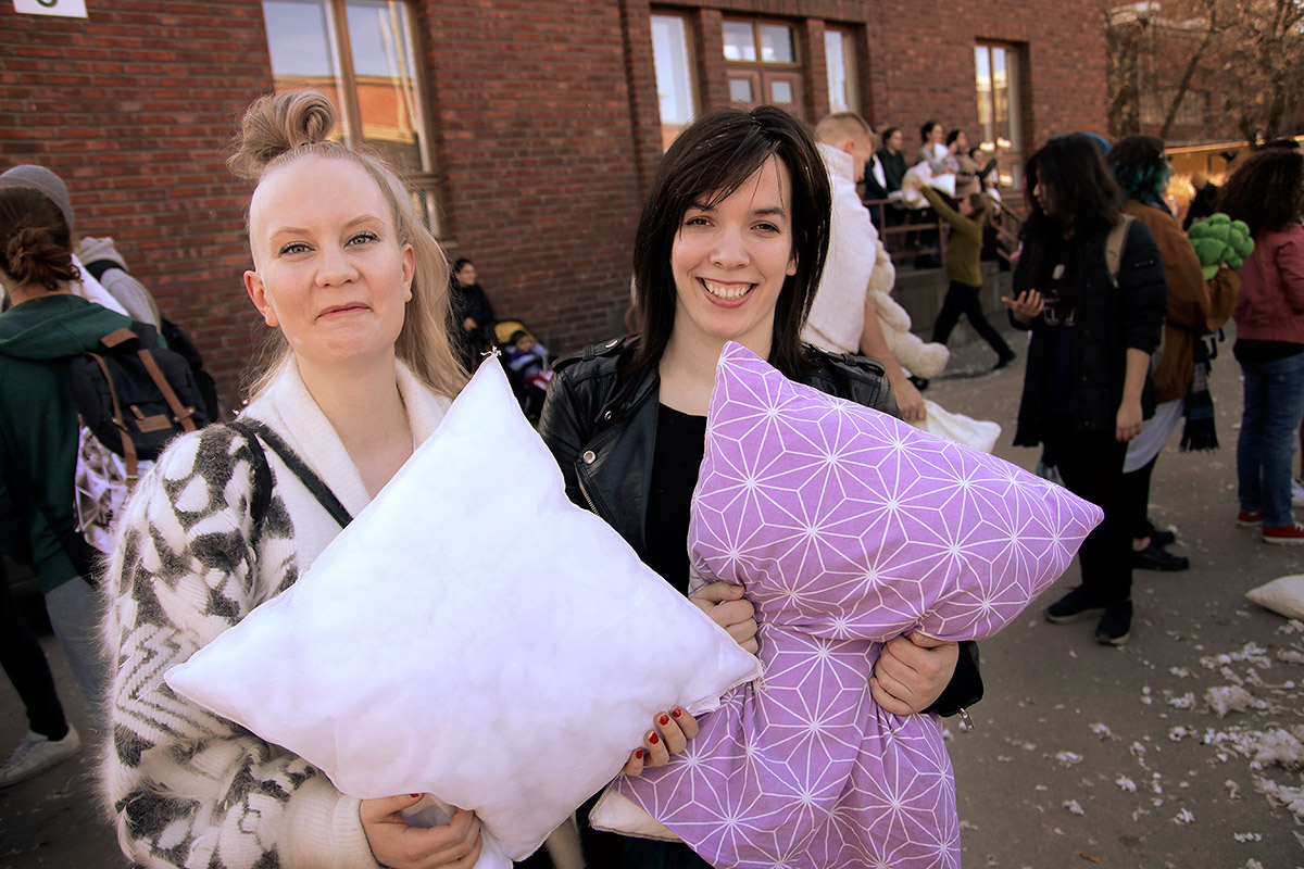 "Helmi Patjas, 25, from Helsinki and Anna Bajnai, 24, from Hungary but who just moved to Kallio, learned about the pillow fight day through Facebook. ""When I saw the invitation, I thought that the event spoke to me directly because of my wild and crazy nature,"" Bajnai said and laughed. Picture: Tony Öhberg for Finland Today"