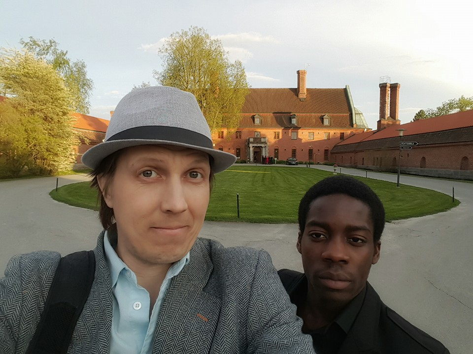 Finland today editor, photographer and reporter Tony Öhberg standing with his colleague, assistant-reporter Samuel Adeoje in front of Vanajanlinna. Picture: Tony Öhberg for Finland Today