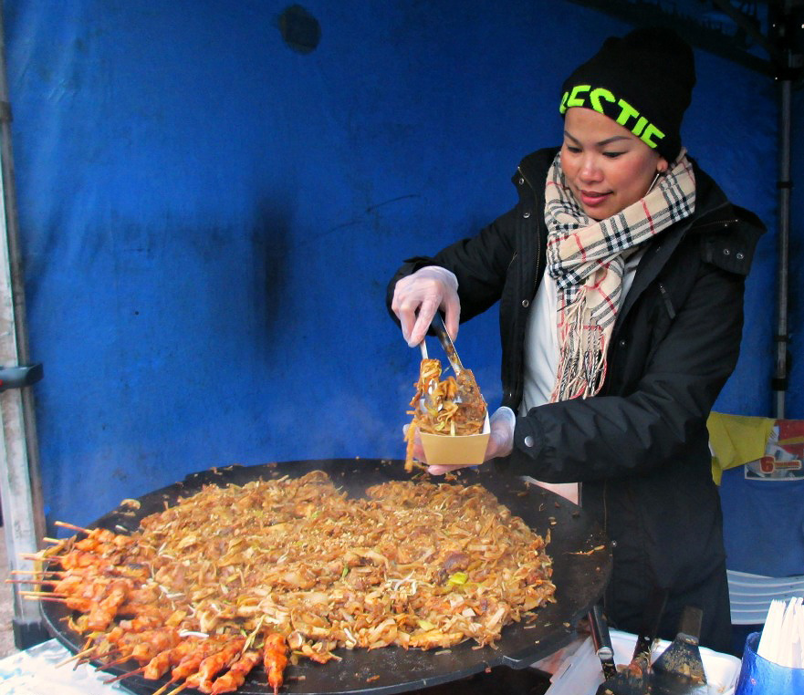 A lady serving Pad Thai, the stir-fried rice noodle dish in Helsinki, Finland on November 21 2015. Picture: Ashley Tukiainen for Finland Today