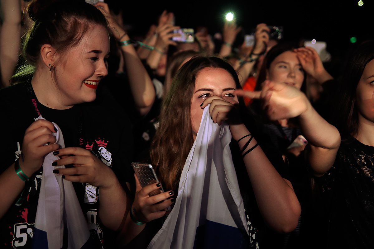 A girl wiping her eyes as the pop-punk band 5 Seconds of Summer perform at Helsinki Arena in Finland on June 3 2016. Picture: Tony Öhberg for Finland Today