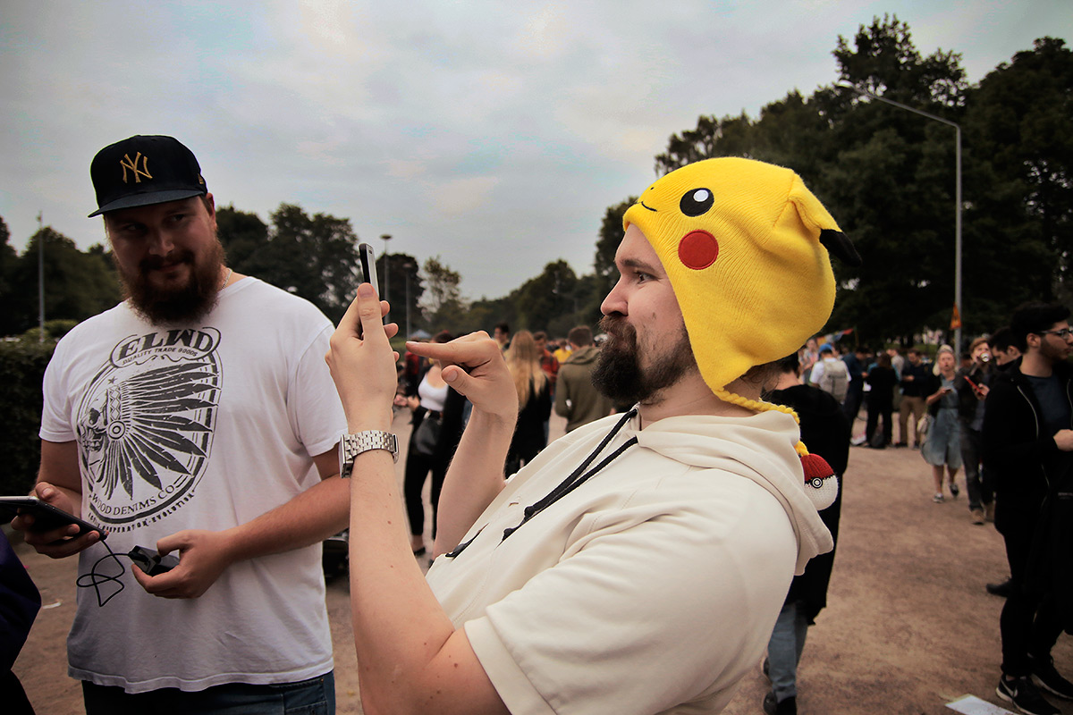 A gamer, wearing a Pikachu hat, furiously tapping his cell while searching for Pokémon. Picture: Tony Öhberg for Finland Today