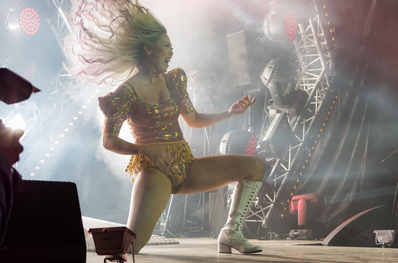 """Manami """"TAM"""" Morita from Japan delivers a gymnastic performance while playing the air guitar that would let an ordinary nightclub dancer go green with envy at the Air Guitar World Championships at the Rotuaari Square in Oulu, Finland on August 26 2016. Picture: Ivika Jäger for Finland Today"""