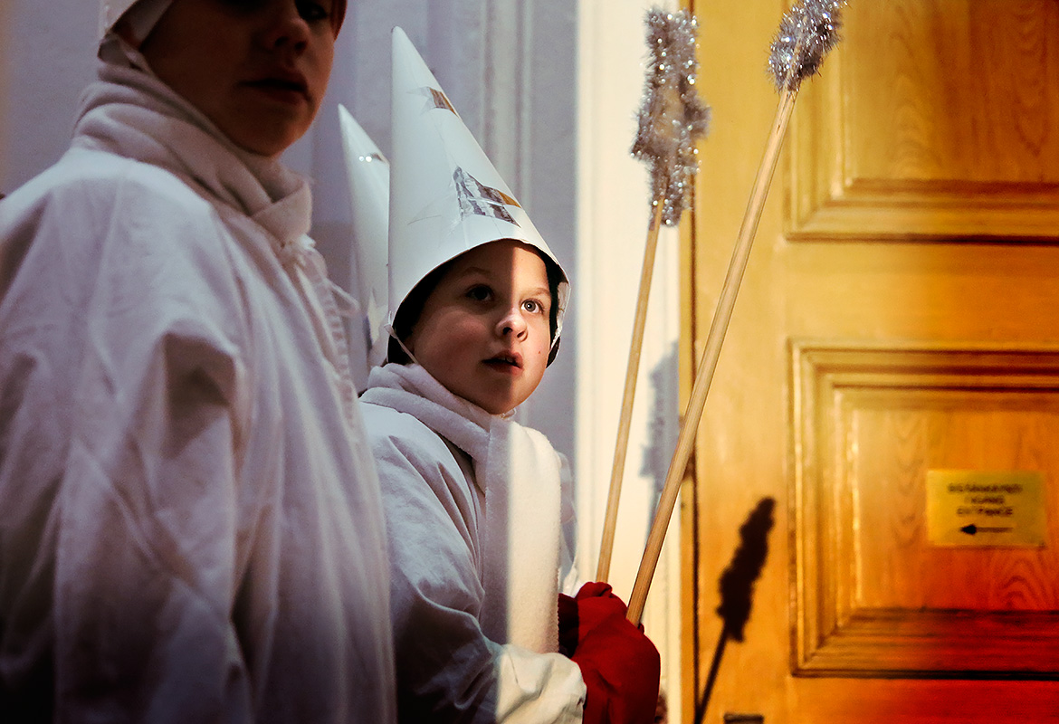 "The star boys wear a similar gown as Lucia but they don't have to wear candles in their hair. It's the boys' ""Lucia moment."" Originally, the character of the star boys is based on the ""Three Wise Men"" who went on a search for the baby boy Jesus in the Bible. Picture: Tony Öhberg for Finland Today"
