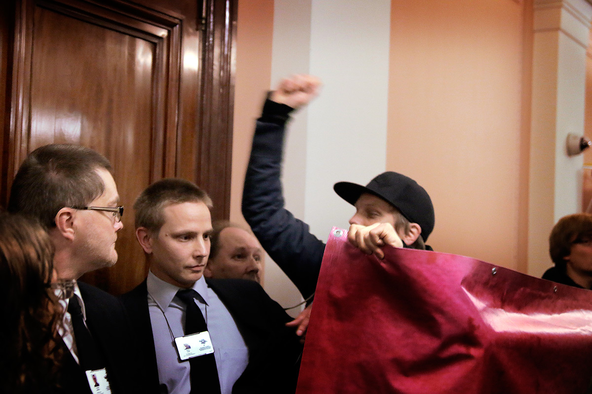 Protesters Wrestle with Security Guards While Trying to Stop Alexander Stubb From Speaking at Helsinki University