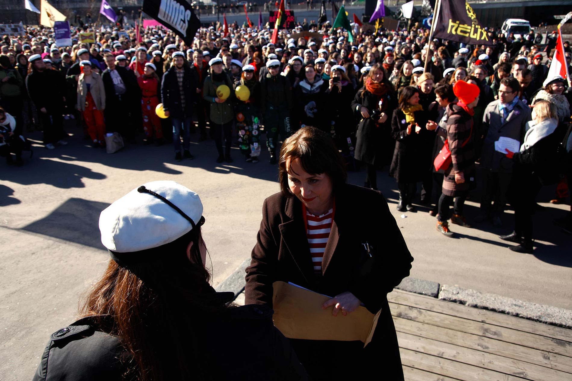 Raija Vahasalo, the chair of the Education and Culture Committee, receiving a petition with a few thousand signatures demanding that the right to student aid is not altered. Picture: Tony Öhberg for Finland Today