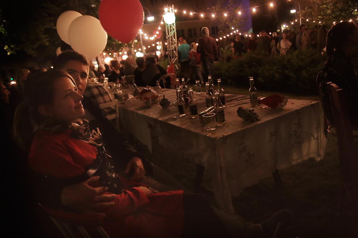 A couple enjoying the party at the Secret Garden.