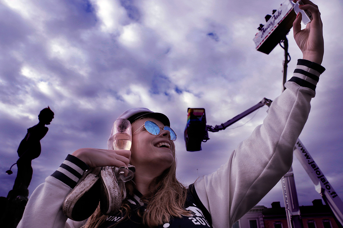 A student's selfie at the statue of Havis Amanda during Vappu (May Day) on May 1, 2016. Picture: Tony Öhberg for Finland Today