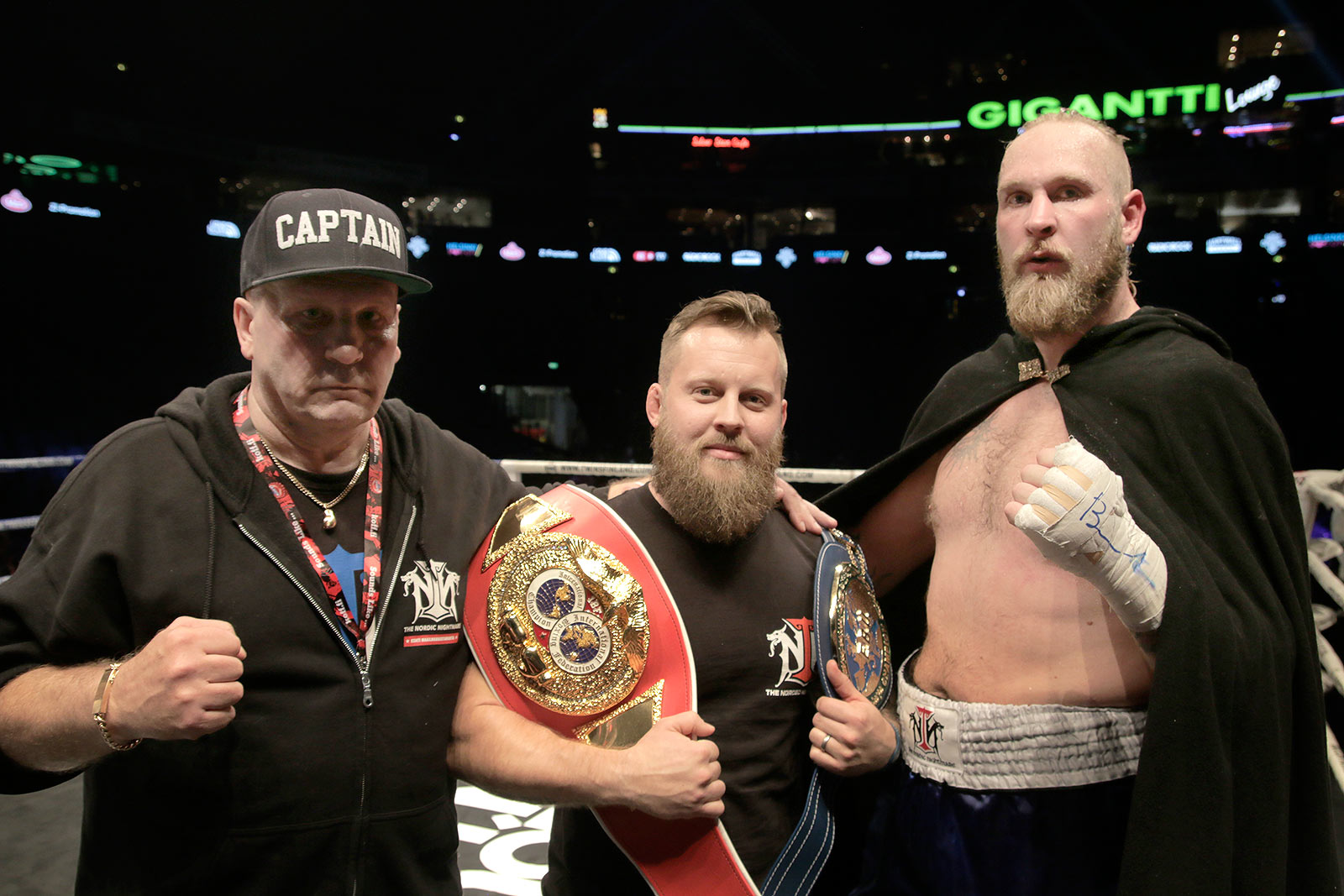 Seppo Finnilä, the cutman, Johan Lindström, the trainer, and the European champion, Robert Helenius posing for Finland Today. Picture: Tony Öhberg for Finland Today