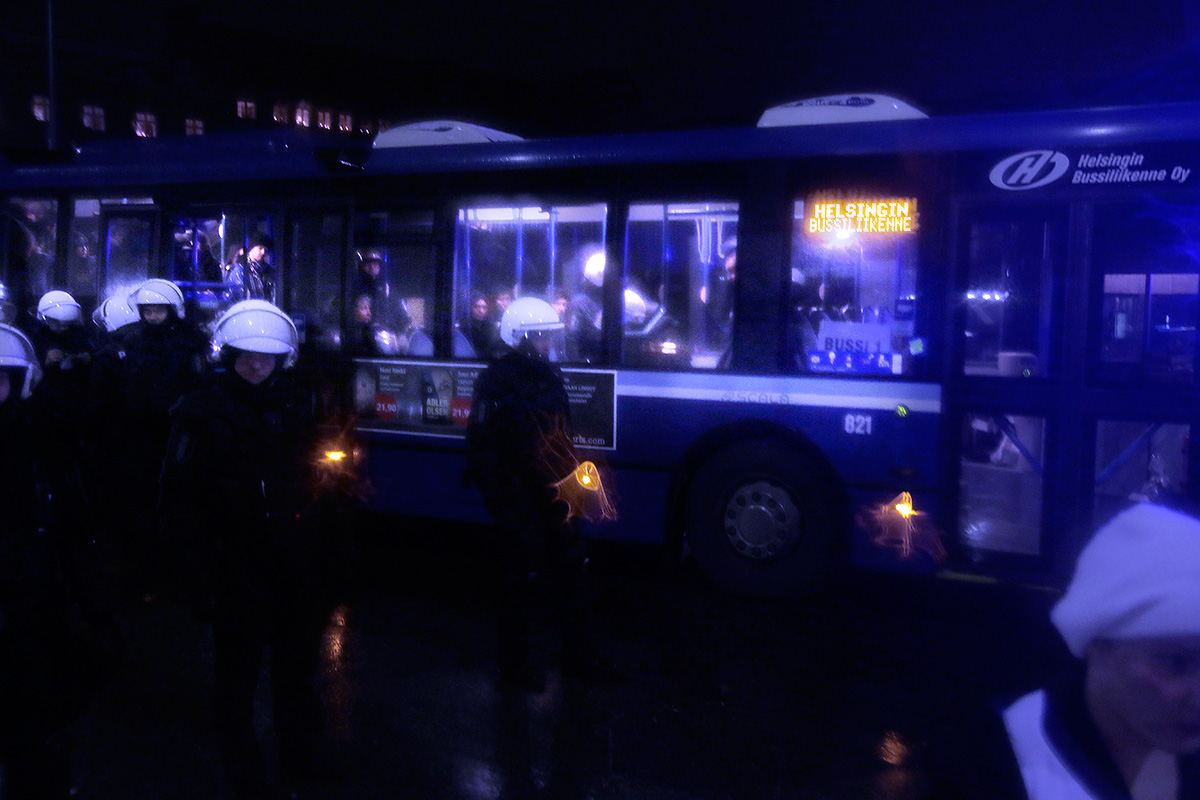 The police arrests people from the Freedom at Stake protest, and loads them in a bus to be carried in jail. Picture: Tony Öhberg for Finland Today