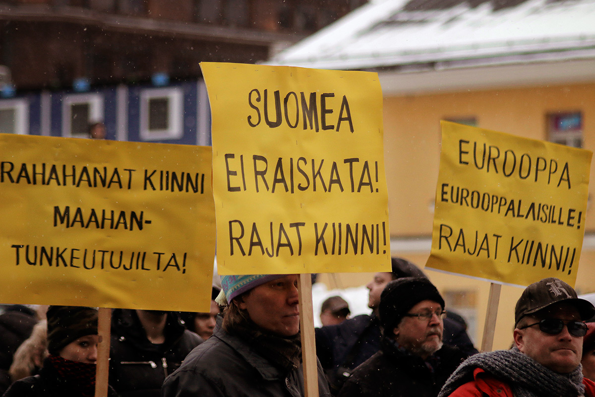 "Protesters displaying banners: ""Close the money taps from the intruders."" ""Finland is not to be raped! Close the borders!"" ""Europe for the Europeans! Close the borders!"" Picture: Tony Öhberg for Finland Today"