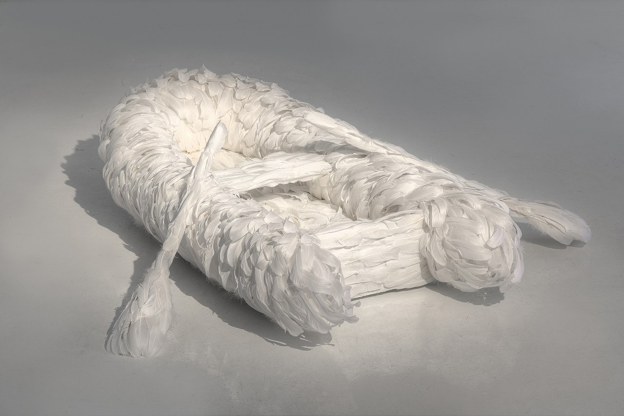 Journey (2016). Goose feathers, steel 31 x 124 x 130 cm. Picture: Ilpo Vainionpää