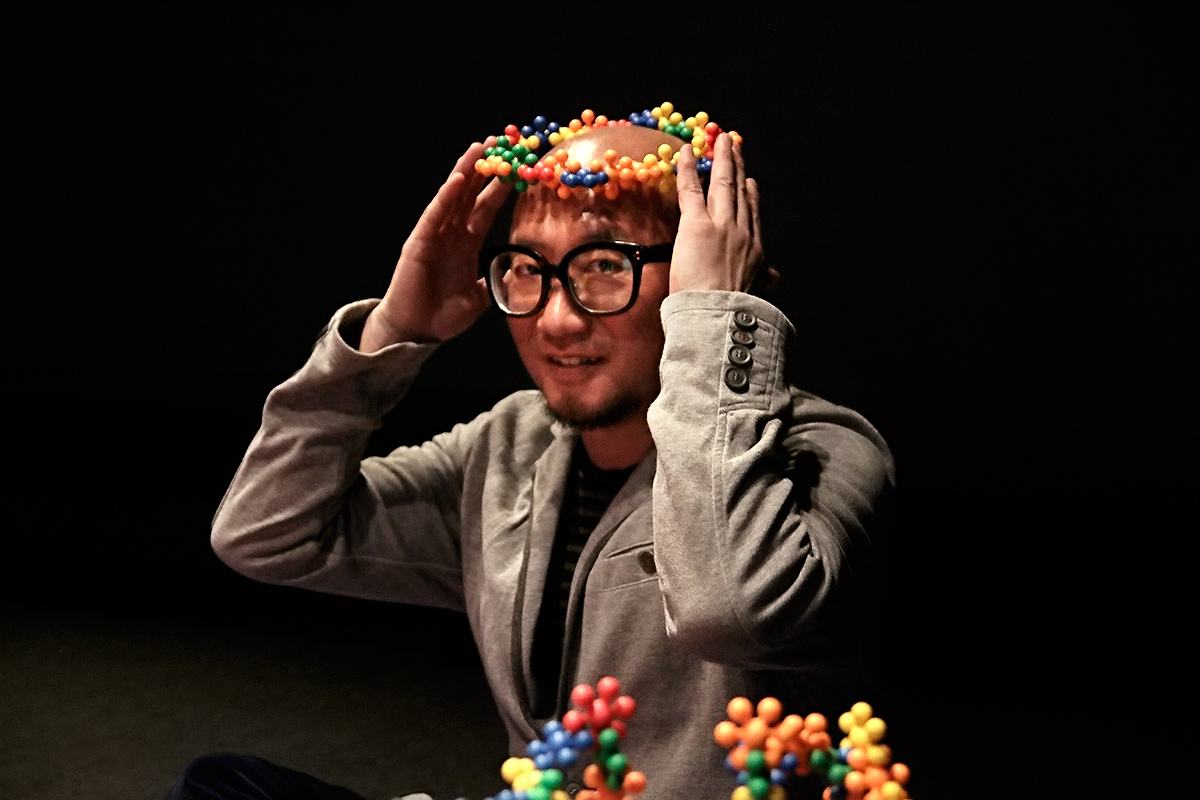 "Choi Jeong Hwa, the Korean contemporary artist, sits in the middle of his construction 'Open Flower' which consists of small plastic, connectable forms that Choi calls ""plastic flower seeds"" at the Kiasma contemporary museum of art in Helsinki, Finland on April 20 2016. Picture: Tony Öhberg for Finland Today"