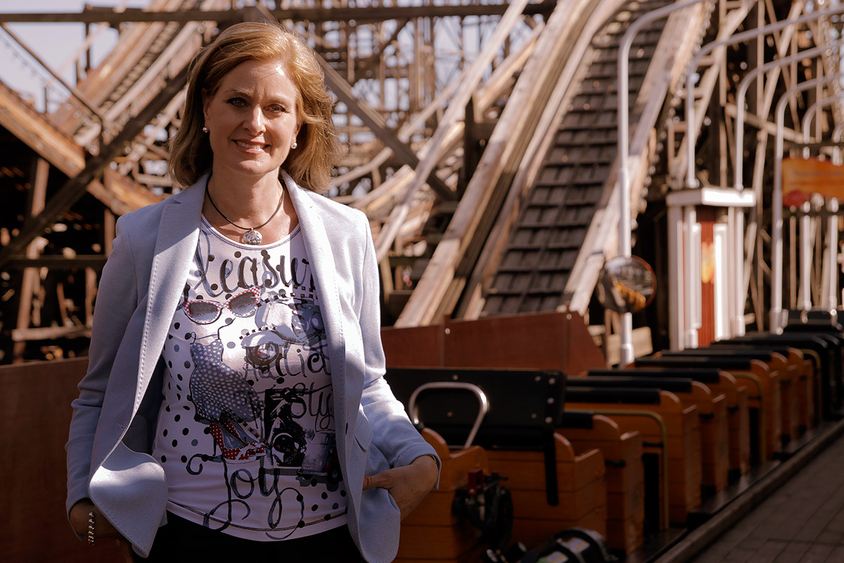 Pia Adlivankin, CEO of Linnanmäki, standing in front of Vuoristorata (the Roller Coaster), built in 1951. It's the oldest ride in the park. Picture: Tony Öhberg for Finland Today