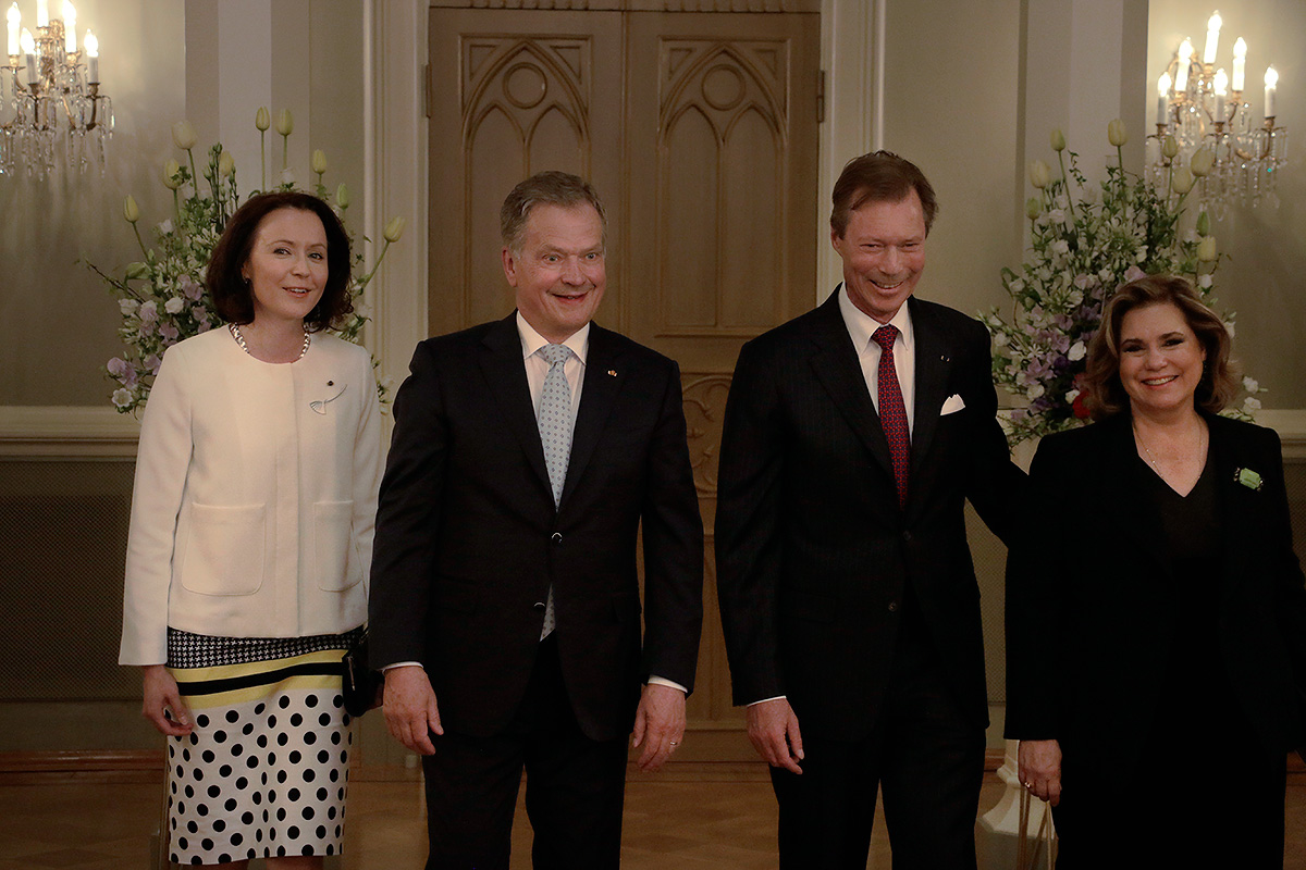 Mrs Jenni Haukio, President Sauli Niinistö, Grand Duke Henri of Luxembourg and Grand Duchess Maria Theresa posing at the Gothic Hall of the Presidential Palace. Picture: Tony Öhberg for Finland Today