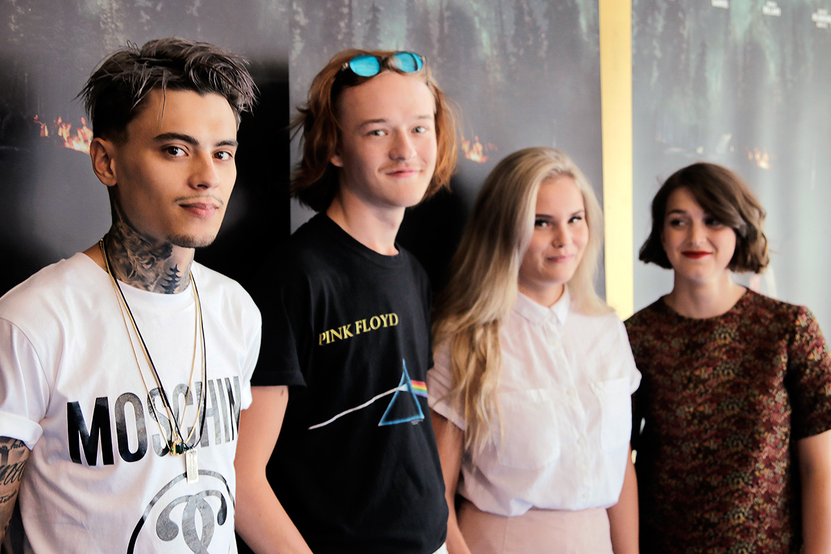 Mikael Gabriel, the Finnish rapper/actor plays charismatic Elias, in Taneli Mustonen's film 'Bodom'. To his right stands Santeri Hellinheimo Mäntylä, who plays Atte, a young man trying to solve the Bodom mystery. To his right, Nelly Hirst-Gee, who plays Iida. And far on the right stands Mimosa Willamo, who plays Noora. The actors are posing in front of Finnkino's Scape theater in Helsinki, Finland on August 3 2016. Picture: Tony Öhberg for Finland Today