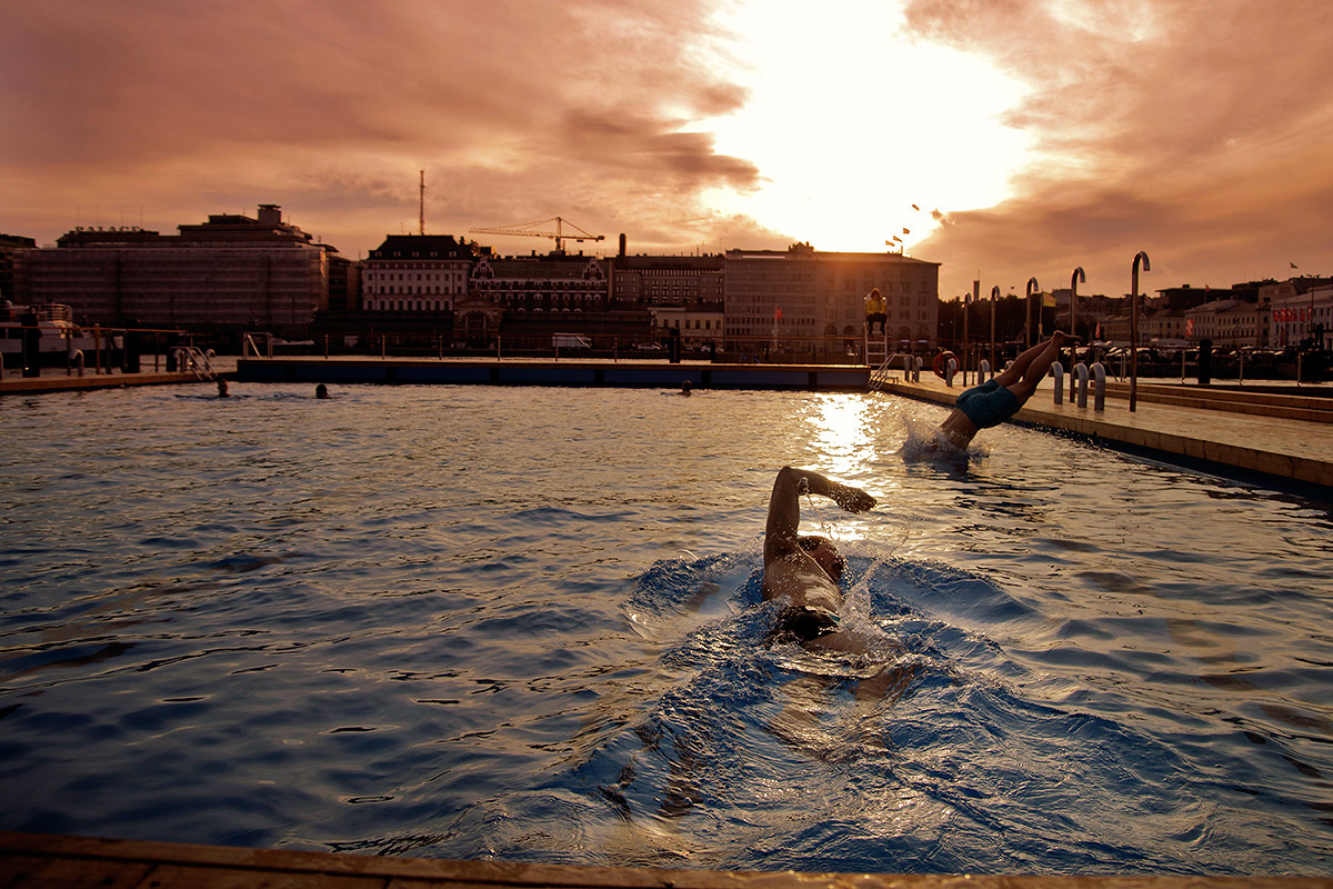 Patrons swimming at the floating fresh water pool during the opening ceremony of Allas Sea Pool on September 2 at Katajanokanlaituri in Helsinki, Finland. Picture: Tony Öhberg for Finland Today