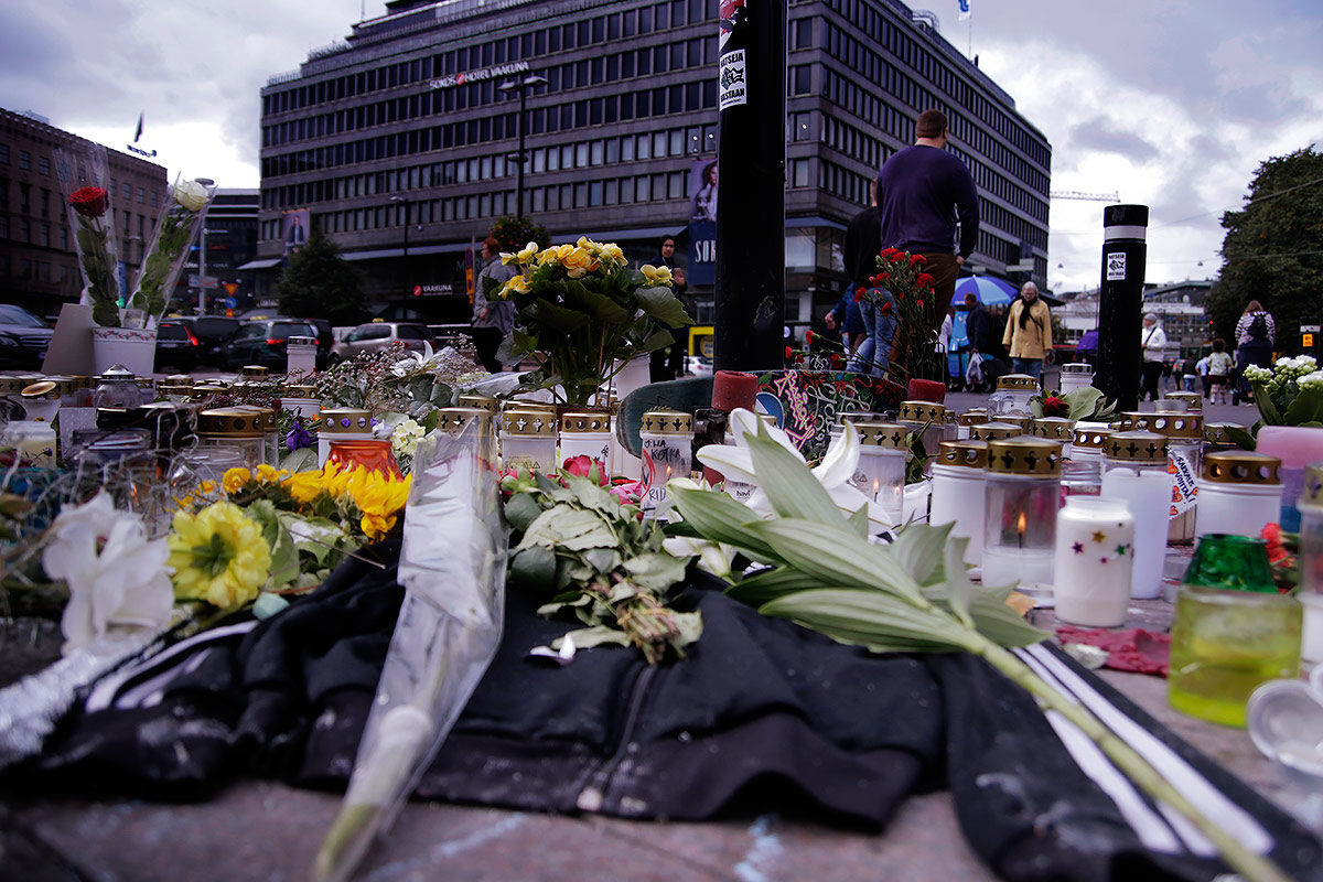 An old, dirty Adidas jacket and a skateboard lay among the candles and flowers. Picture: Tony Öhberg for Finland Today
