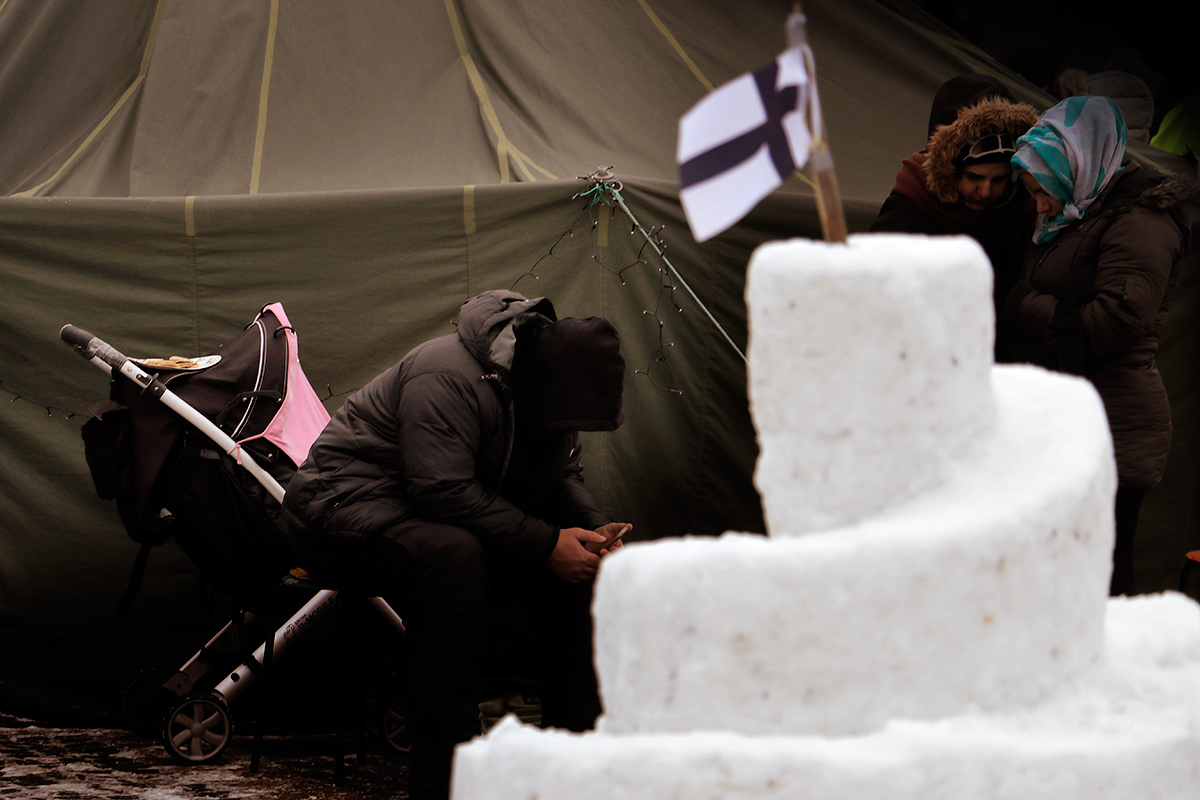A refugee man sitting in front of a tent pitched by Afghan and Iraqi refugees who protest against deportation to their unsafe homelands, at the Railway Square on February 28. Picture: Tony Öhberg for Finland Today
