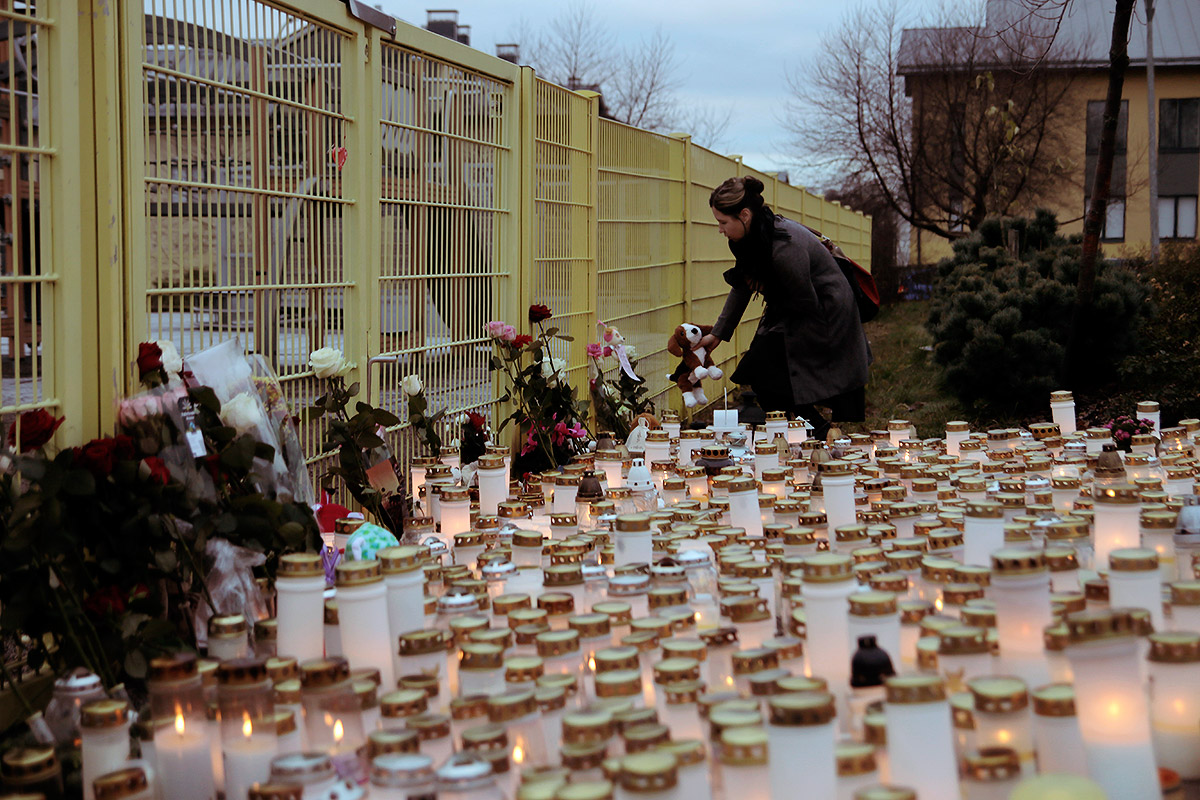 Candles, Teddy Bears and Roses Block the Entrance to the Playground in Porvoo Where Girl, 3, Was Murdered