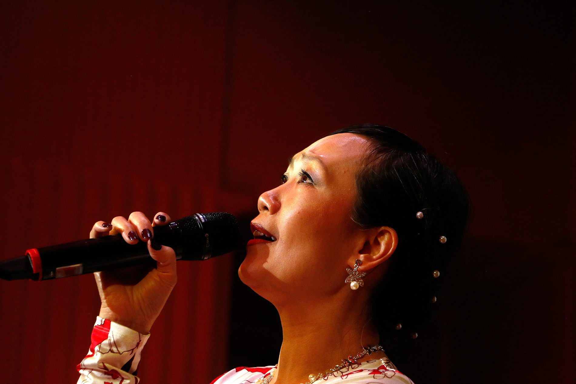 Changling He was a popular singer in China. At the casino, she showcases her talent by performing a song from 'The Bund,' a Hong Kong period drama television series from the 1980s. Picture: Tony Öhberg for Finland Today