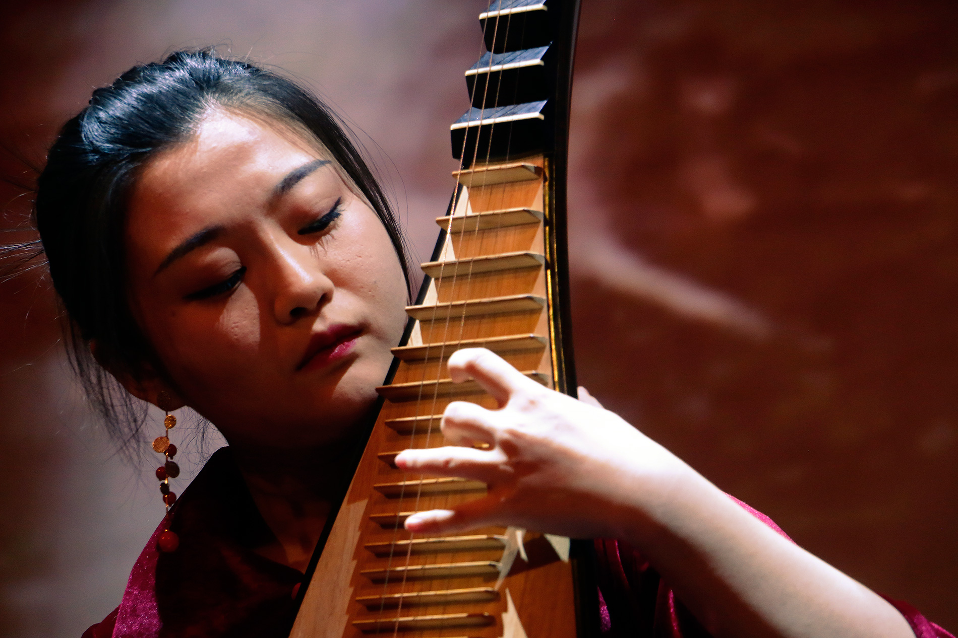 Siyang Chou shows proficiency in playing the Chinese lute, also known as the pipa. It's a four-stringed instrument dating back for almost two thousand years. Picture: Tony Öhberg for Finland Today