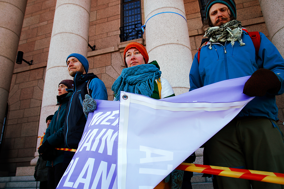 Protesters surrounded by police tape. Picture: Tony Öhberg for Finland Today
