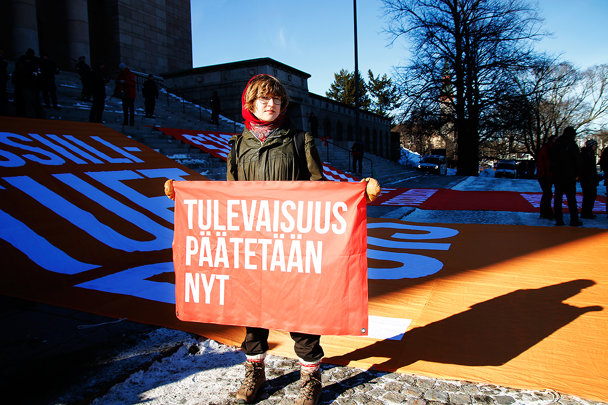 """The banner says: """"THE FUTURE IS DECIDED NOW."""" Picture: Tony Öhberg for Finland Today"""