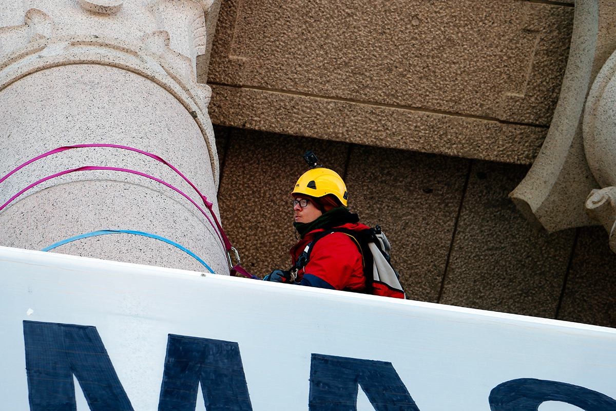 A protester at the pillars. Picture: Tony Öhberg for Finland Today