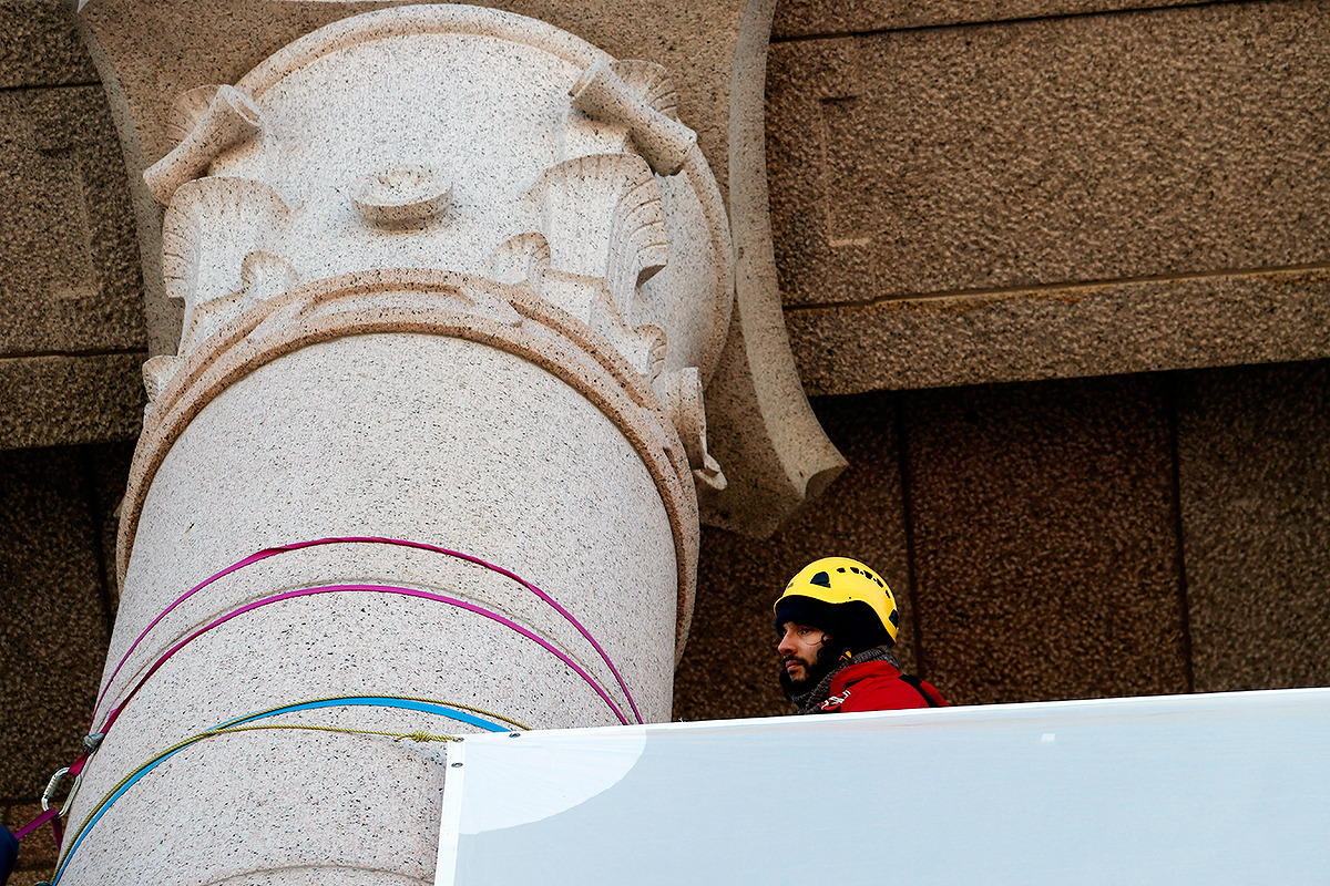 Another protester holding on to the stone column. Picture: Tony Öhberg for Finland Today