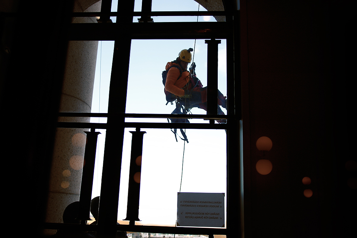 A climber as seen from inside the Parliament Building. Picture: Tony Öhberg for Finland Today