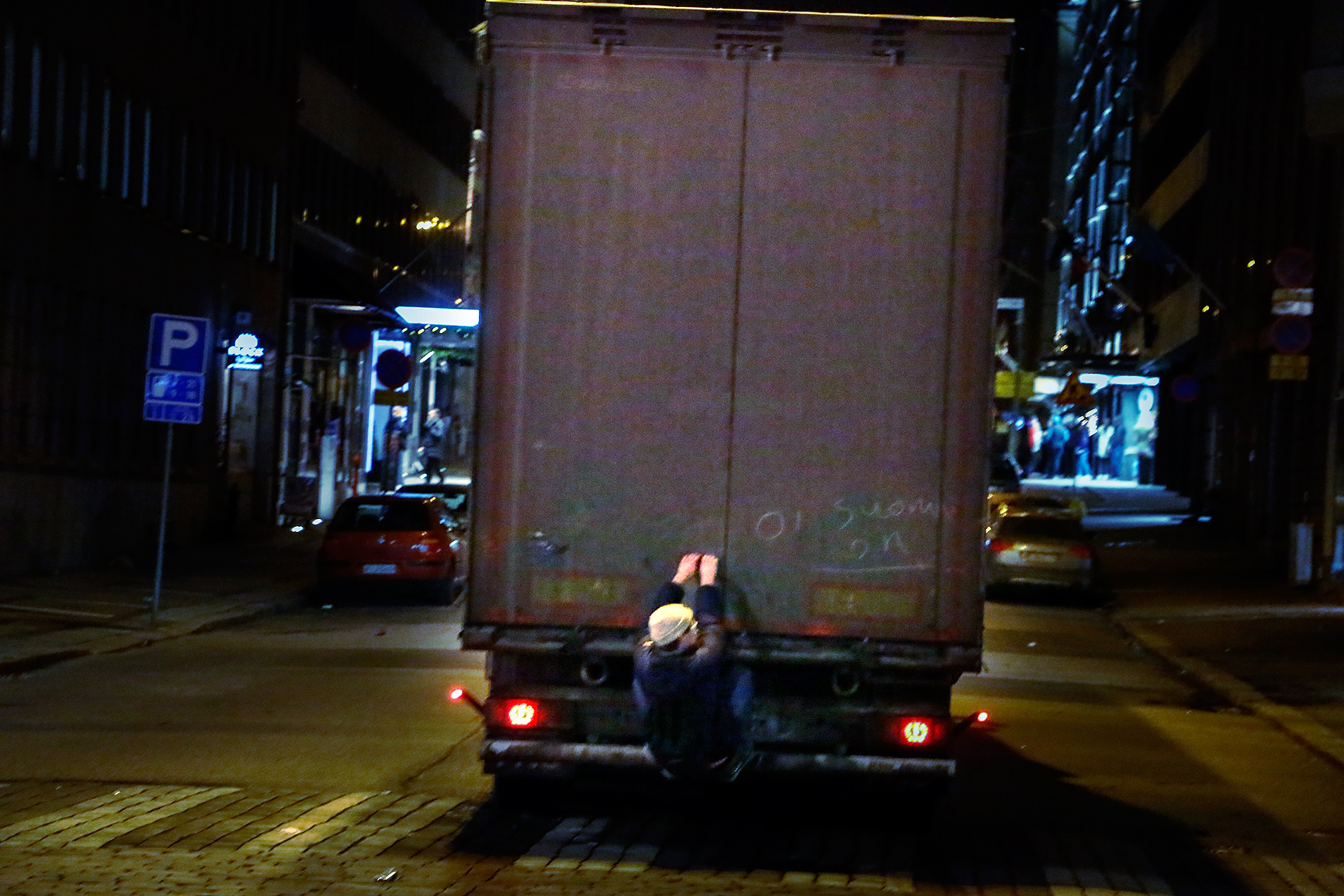 After failing to stop the truck from passing by, this fan jumped on the rear bumper and was able to hold on while the truck started speeding. After about one hundred meters the man fell down in the street. Picture: Tony Öhberg for Finland Today