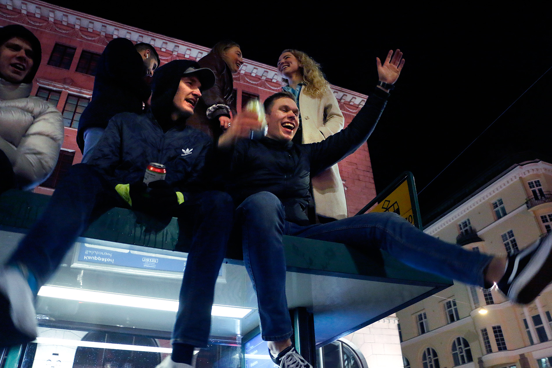 Celebrating on top of the tram stop. Picture: Tony Öhberg for Finland Today