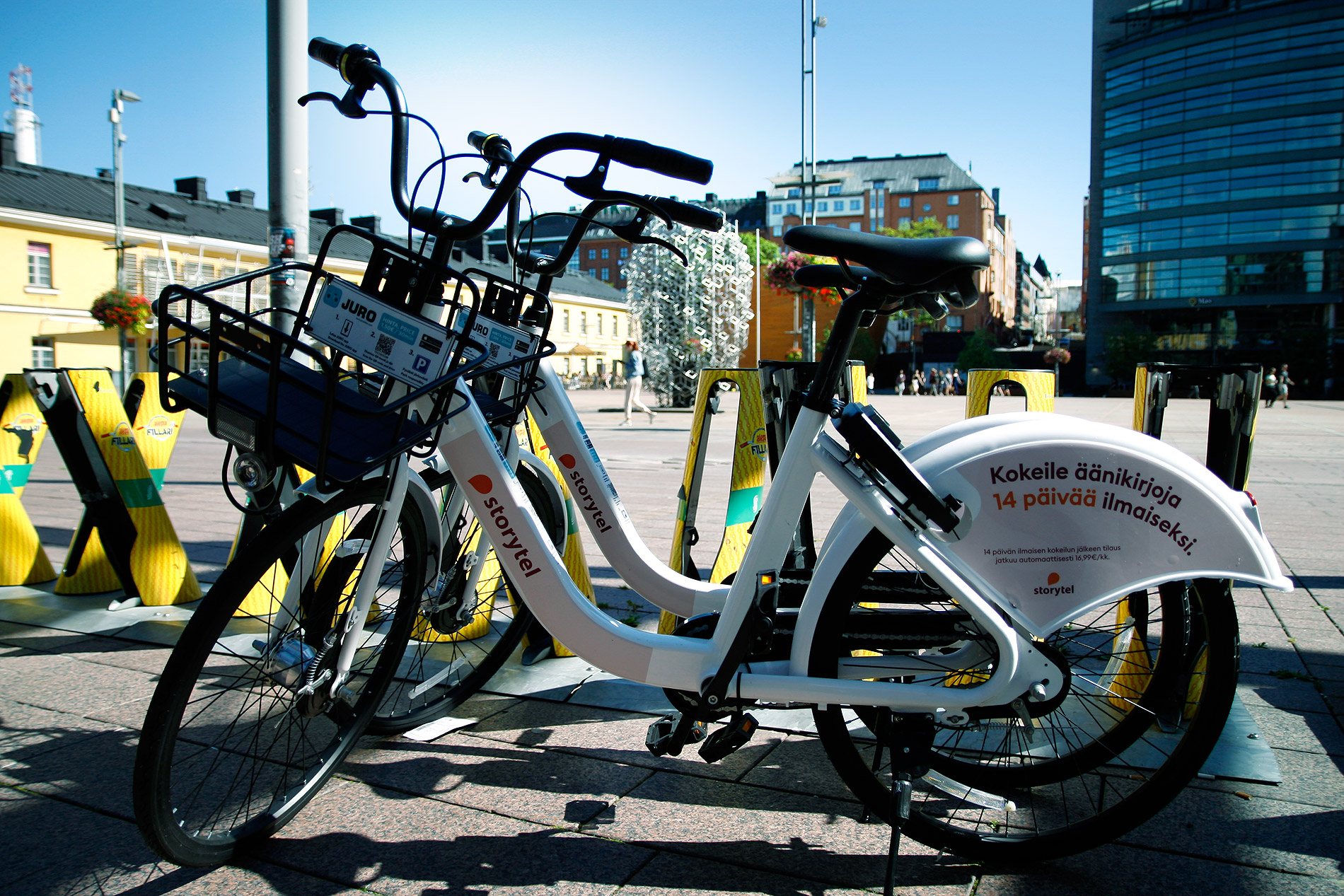 Juro city bikes standing next to a designated station of the yellow Helsinki city bikes in Kamppi district on July 27, 2020. Photograph: Tony Öhberg/Finland Today