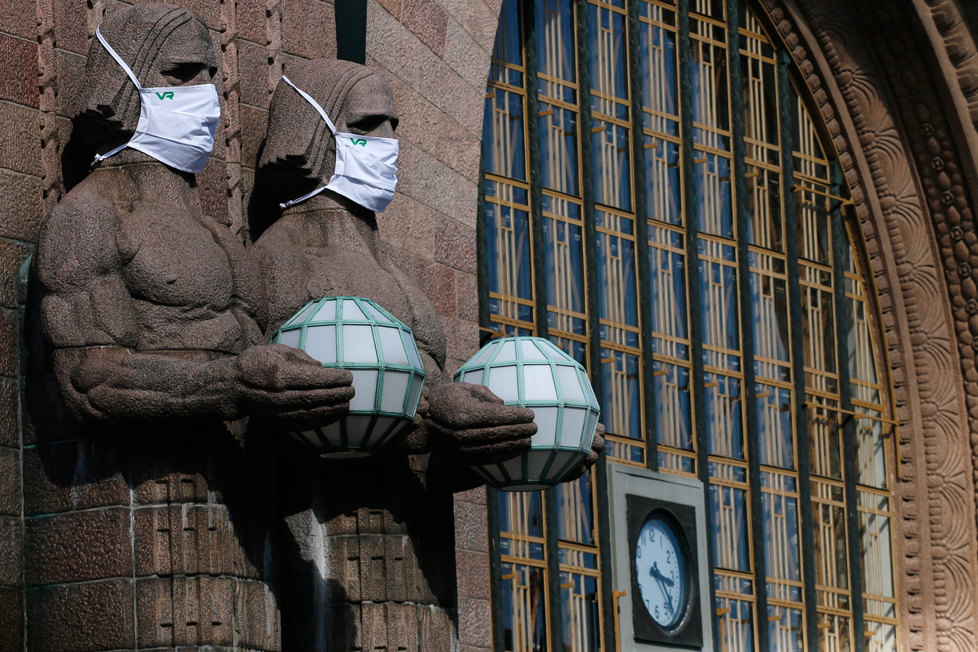 People in Helsinki center began increasingly wearing masks in August, 2020. The iconic statues of the Helsinki Railway Station were clad in face coverings, too. Photograph: Tony Öhberg/Finland Today