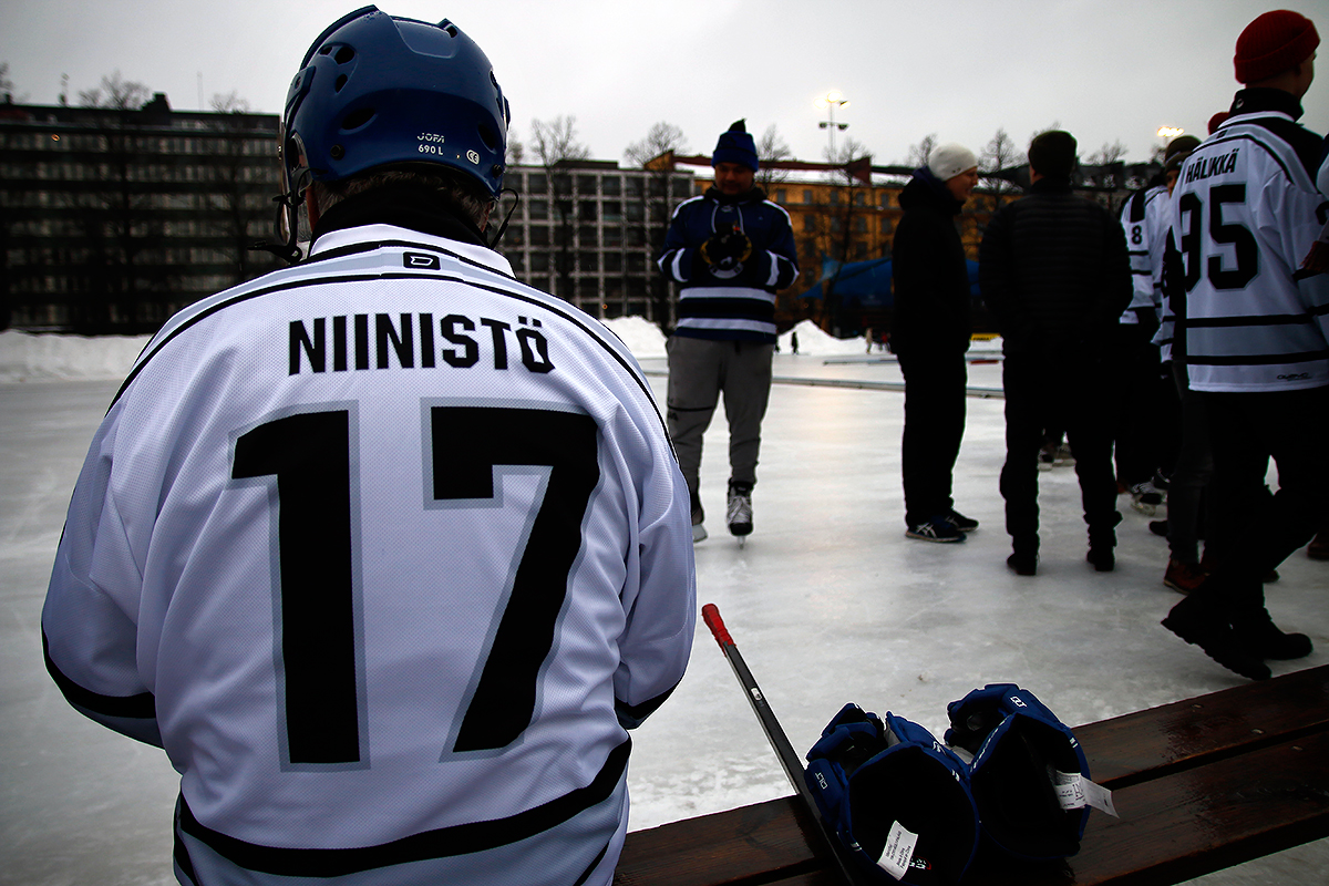 President Sauli Niinistö sitting on a bench at the Kallio Ice Rink (Brahenkenttä) while preparing for a game of Save Pond Hockey in Helsinki on February 9, 2019. Picture: Tony Öhberg for Finland Today