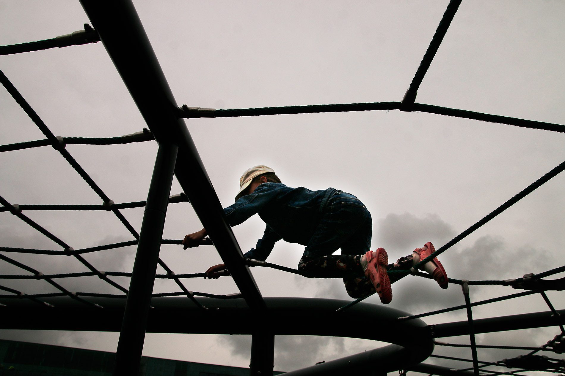 Venla, 8, is trying out Finland's biggest known net climbing frame at the opening of Playground Loru's outdoor play area in front of the Oodi Central Library. Picture: Tony Öhberg for Finland Today