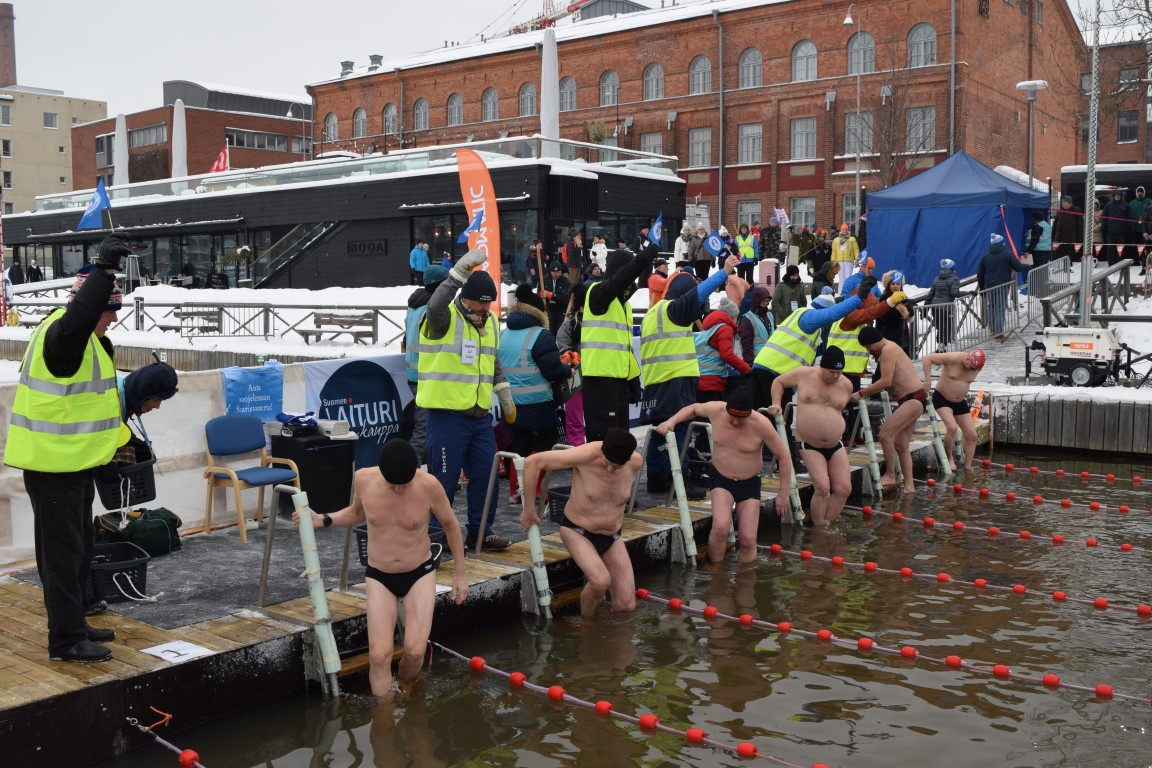 Competitors are ready to take the plunge in the icy Aura River. Picture: Kathleen Cusack for Finland Today